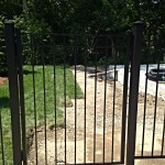 Fully custom wrought iron metal double bar single entrance gate with custom heavy duty hinges and caps